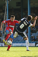 Picture by David Horn/Focus Images Ltd +44 7545 970036.08/09/2012.Luke Howell of Dagenham and Redbridge and Michael Timlin of Southend United during the npower League 2 match at Roots Hall, Southend.