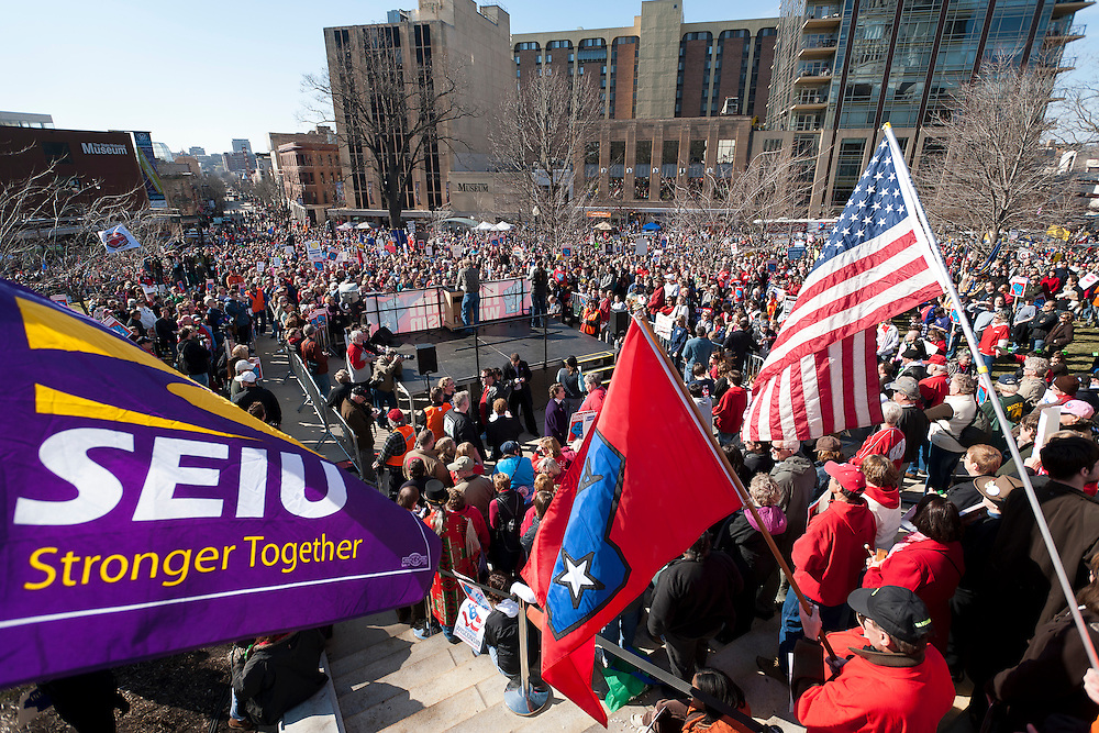 Members of Service Employees International Union (SEIU) Wisconsin Healthcare were among more than 60,000 citizens, public workers, teachers and union members gathered during a Reclaim Wisconsin protest rally held outside the Wisconsin State Capitol in Madison, Wis., on March 10, 2012. One year earlier, Wisconsin's Republican-controlled legislature pushed through Gov. Scott Walker's bill to strip unions and public workers of many collective bargaining rights. (Photo by Jeff Miller for SEIU)