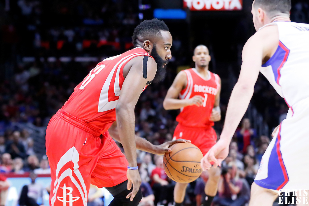 11 February 2015: Houston Rockets guard James Harden (13) drives past Los Angeles Clippers guard J.J. Redick (4) during the Los Angeles Clippers 110-95 victory over the Houston Rockets, at the Staples Center, Los Angeles, California, USA.
