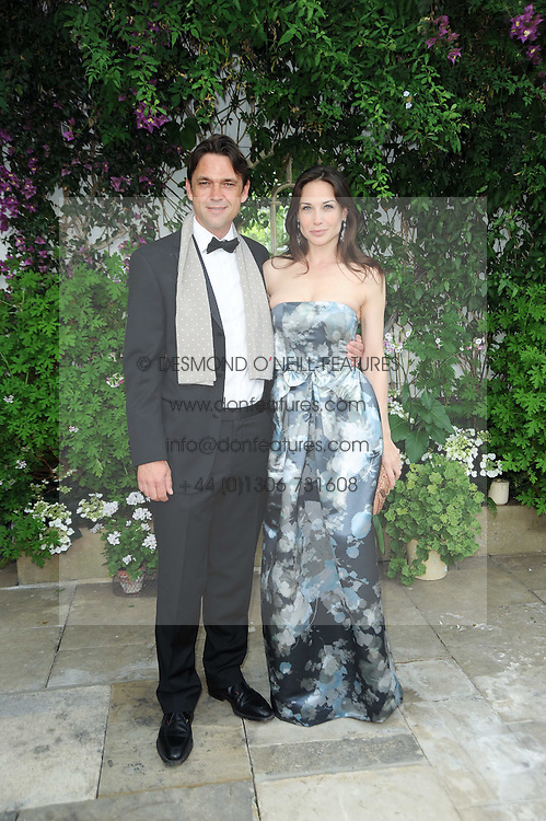 DOUGRAY SCOTT and CLAIRE FORLANI at the Raisa Gorbachev Foundation Party held at Stud House, Hampton Court Palace on 5th June 2010.  The night is in aid of the Raisa Gorbachev Foundation, an international fund fighting child cancer.