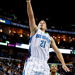 Mar 20, 2013; New Orleans, LA, USA; New Orleans Hornets point guard Greivis Vasquez (21) shoots against the Boston Celtics during the second quarter of a game at the New Orleans Arena. Mandatory Credit: Derick E. Hingle-USA TODAY Sports