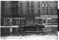 Car downtown, with snow on the ground, New York City. Street photography. 1980