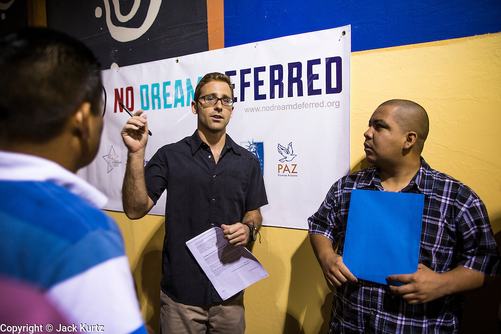 "18 AUGUST 2012 - PHOENIX, AZ:  JOHNNY SINODIS, an immigration and criminal defense lawyer, talks to young people about the ""deferred action"" program during a deferred action workshop in Phoenix. More than 1000 people attended a series of 90 minute workshops in Phoenix Saturday on the ""deferred action"" announced by President Obama in June. Under the plan, young people brought to the US without papers, would under certain circumstances, not be subject to deportation. The plan mirrors some aspects the DREAM Act (acronym for Development, Relief, and Education for Alien Minors), that immigration advocates have sought for years. The workshops were sponsored by No DREAM Deferred Coalition.  PHOTO BY JACK KURTZ"
