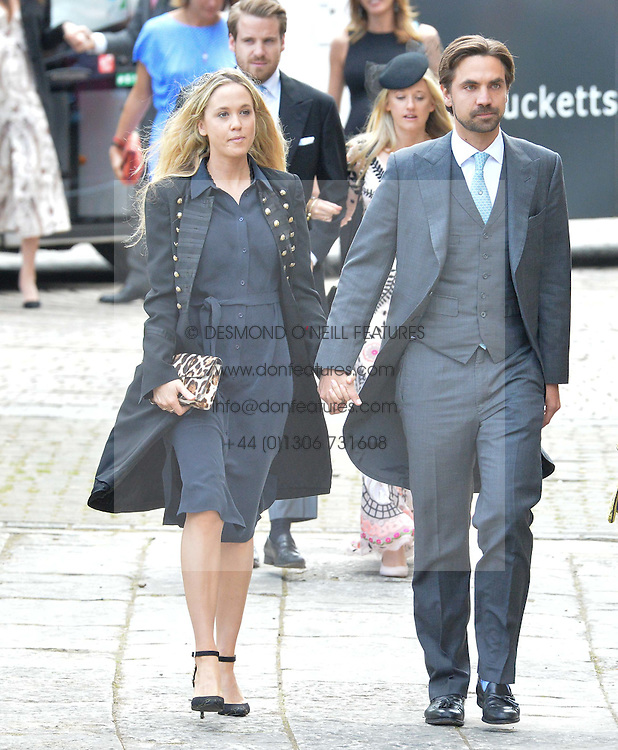 FLORENCE BRUDENELL-BRUCE and her husband HENRY ST.GEORGE at the wedding of the Hon.Alexandra Knatchbull to Thomas Hooper held at Romsey Abbey, Romsey, Hampshire on 25th June 2016