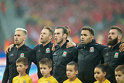 LILLE, FRANCE - Friday, July 1, 2016: Wales players sing the national anthem ahead of the the UEFA Euro 2016 Championship Quarter-Final match against Belgium at the Stade Pierre Mauroy. Aaron Ramsey, Chris Gunter, Gareth Bale, Hal Robson-Kanu. (Pic by Paul Greenwood/Propaganda)