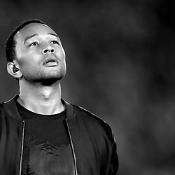 Artist John Legend sings the National Anthem prior to the BCS National Championship game between Auburn and Florida State at the Rose Bowl in Pasadena, Calif., on Monday, Jan. 6, 2014.