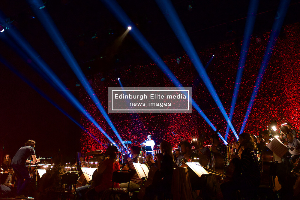 An epic reimagining of the visionary GRIT, the final album by pioneering Scottish piper, fiddler and studio mixer Martyn Bennett, bringing together an 80-piece orchestra, plus folk and jazz instrumentalists and singers, many deeply associated with Bennett himself.(c) Brian Anderson | Edinburgh Elite media