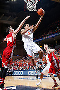 CHARLOTTESVILLE, VA - DECEMBER 4: Malcolm Brogdon #15 of the Virginia Cavaliers drives to the basket against the Wisconsin Badgers during the Big Ten/ACC Challenge game at John Paul Jones Arena on December 4, 2013 in Charlottesville, Virginia. Wisconsin won 48-38. (Photo by Joe Robbins) *** Local Caption *** Malcolm Brogdon