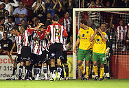 London - Tuesday, August 18th, 2009: Dejected Norwich players after Brentford score the second goal against Norwich City during the Coca Cola League One match at Griffin Park, London. (Pic by Chris Ratcliffe/Focus Images)
