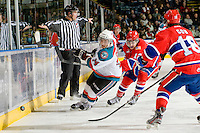 KELOWNA, CANADA, JANUARY 4: Cody Chikie #14 of the Kelowna Rockets is checked by Marek Kalus #12 of the Spokane Chiefs as the Spokane Chiefs visit the Kelowna Rockets on January 4, 2012 at Prospera Place in Kelowna, British Columbia, Canada (Photo by Marissa Baecker/Getty Images) *** Local Caption ***