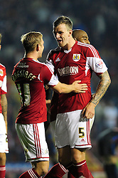 Bristol City's Scott Wagstaff celebrates his goal with Bristol City's Aden Flint   - Photo mandatory by-line: Dougie Allward/JMP - Tel: Mobile: 07966 386802 27/08/2013 - SPORT - FOOTBALL - Ashton Gate - Bristol - Bristol City V Crystal Palace -  Capital One Cup - Round 2