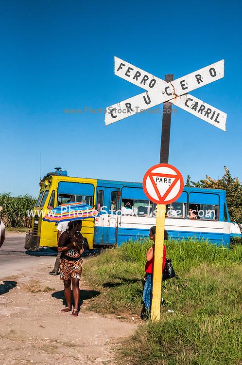 Cuba Santiago de Cuba, Ferro Carril Crucero rail level crossing. An old bus used as a train