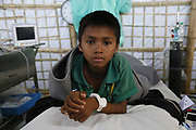 Eight-year-old Saddam, pictured in a clinic in the Kutupalong camp for Rohingya refugees in southern Bangladesh, a day after receiving treatment for Diphtheria, a deadly infectious respiratory disease. The outbreak of Diphtheria, which began in late November 2017, is being tackled by international medical teams, including the UK's Emergency Medical Team. Saddam was given the Diphtheria Anti-Toxin by doctors from the UK EMT on 15 January. Within 24 hours he had made a remarkable recovery and was expected to be discharged the following day. Other members of his family including his brother and father were also given antibiotics to prevent them from contracting the disease or developing the symptoms of it in case they had already been infected.<br /> <br /> Picture: Russell Watkins/Department for International Development