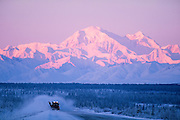 Alaska. Summit. Blowing snow on the George Parks Highway, Alaska Range in distance.