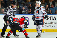 KELOWNA, BC - OCTOBER 12: Linesman Riley Balson awaits a new player for the face off against Liam Kindree #26 of the Kelowna Rockets as Connor Zary #18 of the Kamloops Blazers argues his position at Prospera Place on October 12, 2019 in Kelowna, Canada. (Photo by Marissa Baecker/Shoot the Breeze)