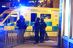 Armed police next to an ambulance after a suspected terrorist attack at the Manchester Arena at the end of a concert by US star Ariana Grande left 19 dead.