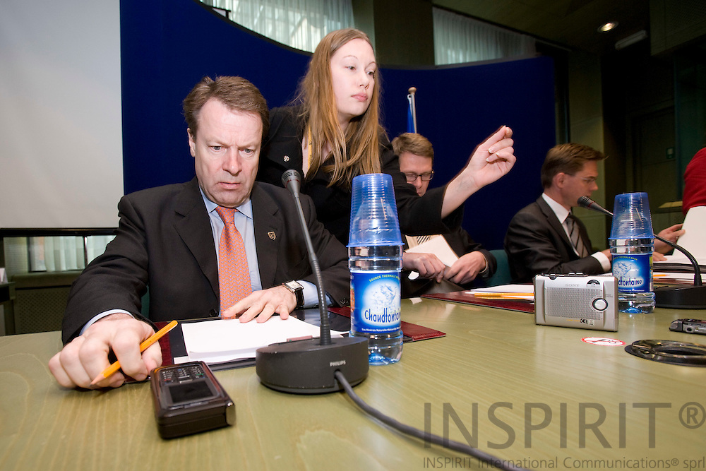 BRUSSELS - BELGIUM - 14 MARCH 2008 --  EUROPEAN COUNCIL SUMMIT SLOVENIAN PRESIDENCY -- Ilkka KANERVA, Minister of Foreign Affairs of Finland, looking at his GSM at the beginning of the pressbriefing after the summit meeting. Already sitting is the Prime Minister Matti VANHANEN. Photo: Erik Luntang