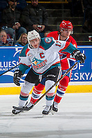 KELOWNA, CANADA - JANUARY 4: Hudson Elynuik #26 of the Spokane Chiefs back checks Rodney Southam #17 of the Kelowna Rockets on January 4, 2017 at Prospera Place in Kelowna, British Columbia, Canada.  (Photo by Marissa Baecker/Shoot the Breeze)  *** Local Caption ***
