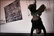 The xx year old Damien is working on his breakdance technique at the HipHop2 (quadrate) School in Arnhem in the Netherlands. At the Hip Hop school youngsters from 10 to 25 can take workshops in rap, hip hop, breakdance and DJ Spinning...In Arnhem is sinds januari 2006 een HipHopschool gevestigd. Op deze school kunnen jongeren van tussen de 10 en 25 jaar workshops volgen in Rap, R&B zang, Breakdance, HipHop dance en DJ Spinning. Dit iniatief is tot stand gekomen door een samenwerking van Stichting Interart en de Arnhemse Rapgroep ' Andere Gekte'.  Arnhem, NETHERLANDS - 15-2-06: