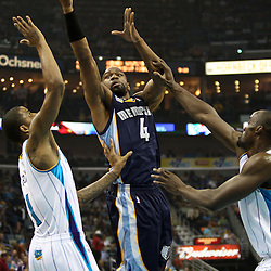 April 1, 2011; New Orleans, LA, USA; Memphis Grizzlies shooting guard Sam Young (4) shoots between New Orleans Hornets small forward Trevor Ariza (1) and center Emeka Okafor (50) during the first quarter at the New Orleans Arena.    Mandatory Credit: Derick E. Hingle