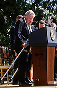 President Bill Clinton with crutches during an event on the Chemical Weapons Ban treaty at the White House event April 4,1997 in Washington, DC.