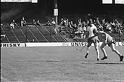 Wexford blocks Cork from behind as she hits the slitor during the All Ireland Senior Camogie Final Cork v Wexford in Croke Park on the 21st September 1975. Wexford 4-3 Cork 1-2.