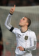 LUKAS PODOLSKI POINTS TO HEAVEN AFTER SCORING.GERMANY V IVORY COAST.GERMANY V IVORY COAST.VELTINS ARENA, GELSENKIRCHEN, GERMANY.18 November 2009.GAA3877..  .WARNING! This Photograph May Only Be Used For Newspaper And/Or Magazine Editorial Purposes..May Not Be Used For, Internet/Online Usage Nor For Publications Involving 1 player, 1 Club Or 1 Competition,.Without Written Authorisation From Football DataCo Ltd..For Any Queries, Please Contact Football DataCo Ltd on +44 (0) 207 864 9121