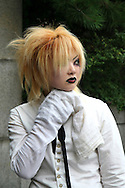 "A wide variety of ""costume play"" getups are shown here: goths, cartoon characters from Japanese manga, anime,  the sweet-and-innocent frilly look or combinations in between (goth lolly)  Every Sunday, these cosplay characters converge on Harajuku, Tokyo's fashion quarter. Most casual observers say that cosplay is a reaction to the rigid rules of Japanese society. But since so many cosplay girls congregate in Harajuku and Aoyama - Tokyo headquarters of Fendi, Hanae Mori and Issey Miyake, others consider it is a reaction to high fashion. Whatever the cause, cosplay aficionados put a tremendous amount of effort into their costumes every Sunday. One wonders what they wear on Monday morning..."