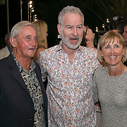 March 6, 2015, Indian Wells, California:<br /> John McEnroe poses with guests during the McEnroe Challenge for Charity VIP Draw Ceremony in Stadium 2 at the Indian Wells Tennis Garden in Indian Wells, California Friday, March 6, 2015.<br /> (Photo by Billie Weiss/BNP Paribas Open)