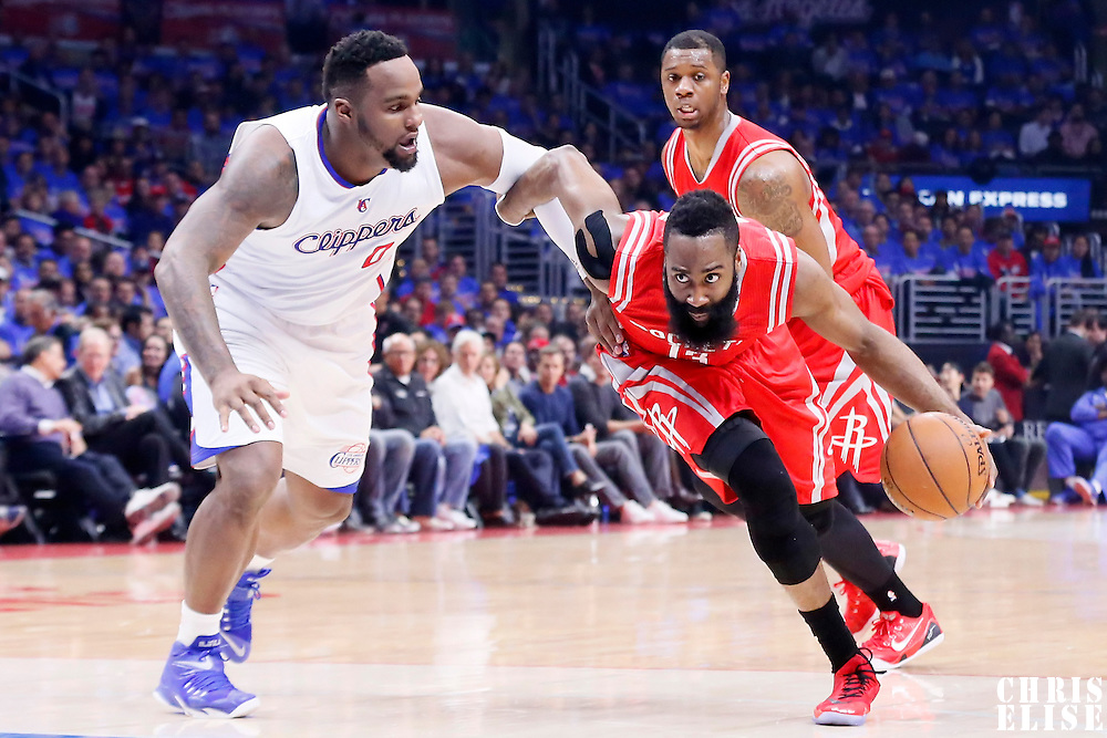 14 May 2015: Houston Rockets guard James Harden (13) drives past Los Angeles Clippers forward Glen Davis (0) during the Houston Rockets 119-107 victory over the Los Angeles Clippers, in game 6 of the Western Conference semifinals, at the Staples Center, Los Angeles, California, USA.