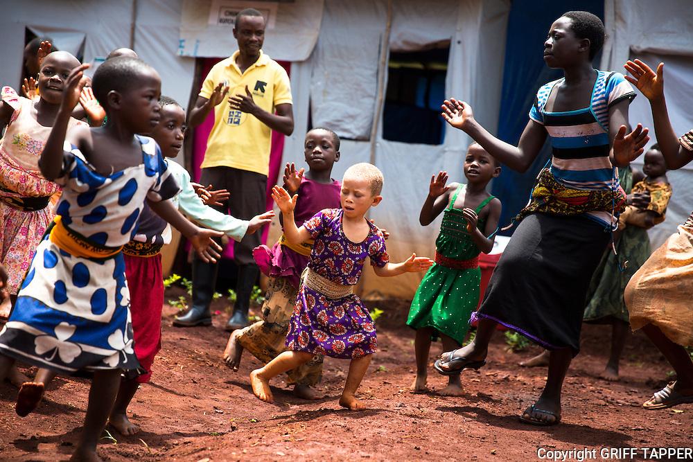 Children dance in an International Rescue Committee disability center in the Nyarugusu refugee camp in Tanzania.