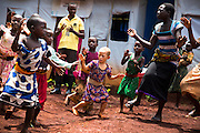 Children dance in an International Rescue Committee disability center in the Nyarugusu refugee camp in Tanzania.