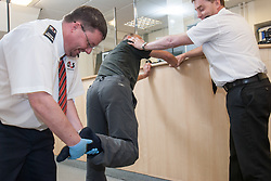 Prisoner at the charge desk of a police station