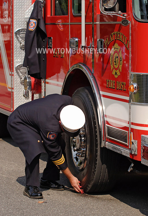 Middletown, N.Y. - A member of the Plattekill Fire Department does some last-minute cleaning on a truck before the start of the Middletown Fire Department Parade on Sept. 9, 2006. ©Tom Bushey