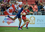 Canada's Matt Mullins breaks past USA's Perry Baker during the HSBC World Rugby Sevens Series, Singapore, Cup Final match USA -V- Canada  at The National Stadium, Singapore on Sunday, April 16, 2017. (Steve Flynn/Image of Sport)