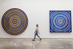 © Licensed to London News Pictures. 19/09/2019. London, UK. A visitor views a painting titled Martyr (2019) by British artist Damien First. The work is part of a new exhibition titled Mandalas showing at the White Cube Gallery Mason's Yard. Photo credit: Ray Tang/LNP