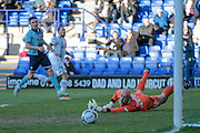 Andy Warrington (Grimsby Town) gets a glove on the ball, then watches as it goes wide from James Norwood's (Tranmere Rovers) shot during the Vanarama National League match between Tranmere Rovers and Grimsby Town FC at Prenton Park, Birkenhead, England on 30 April 2016. Photo by Mark P Doherty.