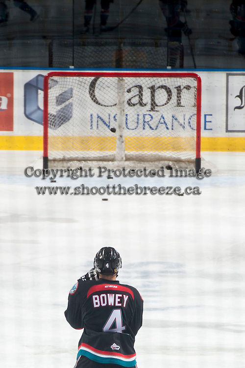 KELOWNA, CANADA - DECEMBER 5: Madison Bowey #4 of Kelowna Rockets stands on the ice during warm up against the Prince George Cougarson December 5, 2014 at Prospera Place in Kelowna, British Columbia, Canada.  (Photo by Marissa Baecker/Shoot the Breeze)  *** Local Caption *** Madison Bowey;