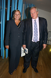 ADAM BOULTON and his wife ANJI HUNTER at a party to celebrate the publication of Glass Houses by Sandra Howard held at Tamesa, Oxo Tower Wharf, Barge House Street, London SE1 on 5th September 2006.<br />