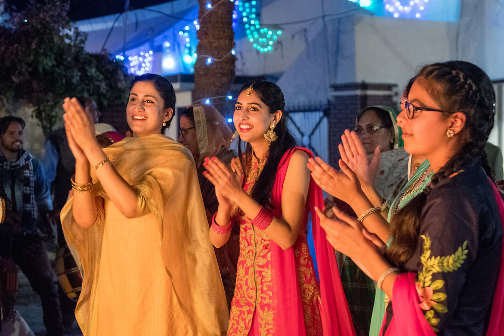 Women dancing at the Lohri celebration in Punjab, India. Lohri is the celebration of longer days of sunlight returning after the Winter solstice.