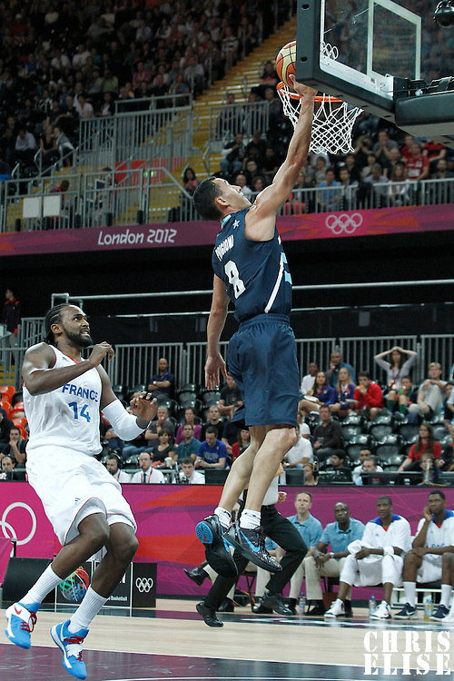 31 July 2012: Argentina Pablo Prigioni goes for the layup during 71-64 Team France victory over Team Argentina, during the men's basketball preliminary, at the Basketball Arena, in London, Great Britain.