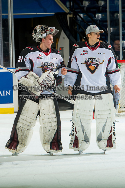 KELOWNA, BC - OCTOBER 03:  Trent Miner #31 and David Tendeck #30 of the Vancouver Giants head to the dressing after the shut out win against the Kelowna Rockets  at Prospera Place on October 3, 2018 in Kelowna, Canada. (Photo by Marissa Baecker/Getty Images)