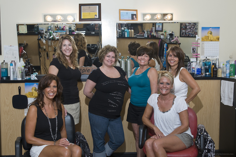 The Place to Go Hairstyling Highlands location at 1607 Bardstown Road in Louisville, Ky., staff, from left to right, are stylists Janell Soeder, Angela O'Neill, Stephanie Walker, Angie Kayrouz, Connie Robinson and Tammi Hendrickson. (The staff also includes Kim Campbell, who was not present for the photo.) (Photo by Brian Bohannon)