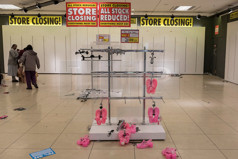 © Licensed to London News Pictures. 28/08/2016. London, UK. Customers visit the BHS store in Harrow, in north west London.  The Harrow store is one of the remaining 22 stores which will close for the last time today,  Shelves, fixtures and fittings are being sold as well as the last remaining stock.  After administrators, failed to find a suitable buyer for the department store chain, the decision was made to close all 164 shops, with the loss of 11,000 jobs. Photo credit : Stephen Chung/LNP
