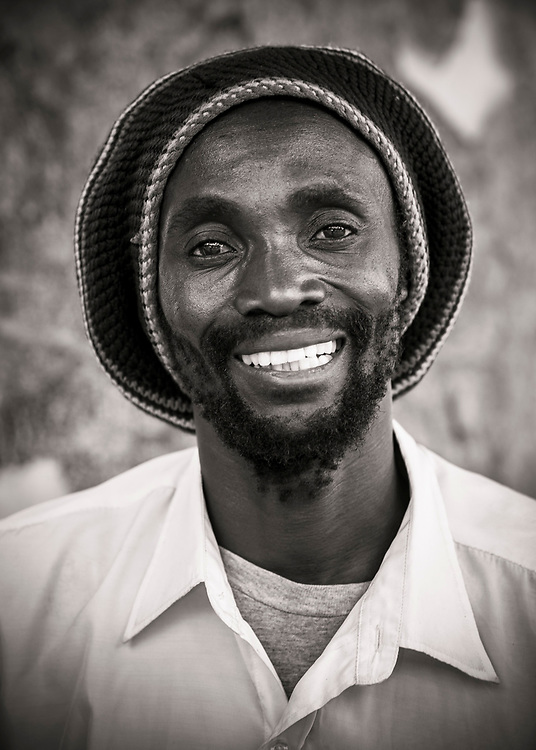 Emmanuel Kapotwe - Zambian artist.  Photographed under a large tree in Lusaka, Zambia, for the World Crafts Council.