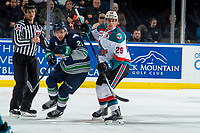 KELOWNA, CANADA - JANUARY 30: Nolan Foote #29 of the Kelowna Rockets checks Matthew Wedman #21 of the Seattle Thunderbirds  on January 30, 2019 at Prospera Place in Kelowna, British Columbia, Canada.  (Photo by Marissa Baecker/Shoot the Breeze)