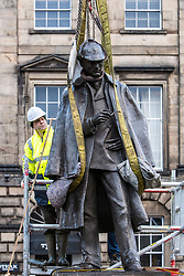 The sculpture of Sherlock Holmes by former pop-artist Gerald Laing is being moved from it's home on Picardy Place, yards from the birth place of Sir Arthur Conan Doyle.<br /> <br /> The move of the sculpture is to accommodate road and tram works that are taking place in Edinburgh. The statue will be moved to Nairn at  Black Isle Bronze Ltd by the artists son, Farquhar Laing where it will stay for two years until it returns to Edinburgh.<br /> <br /> Pictured: The sculptors son, Farquhar Laing checks the lifting straps around his fathers sculpture of Sherlock Holmes