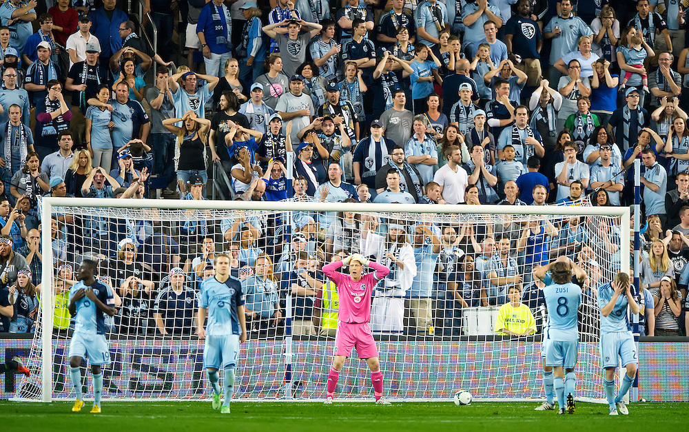 Sporting KC goalkeeper Jimmy Nielsen (1), in pink, reacted to a goal in the 94th minute during second half stoppage time by the Seattle Sounders FC in MLS soccer action on Wednesday, May 8, 2013 at Sporting Park in Kansas City, Kan. Seattle won 1-0.