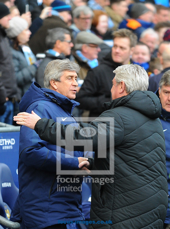 Manchester City manager Manuel Pellegrini (left) shake hands with Hull City manager Steve Bruce prior to the Barclays Premier League match at the Etihad Stadium, Manchester<br /> Picture by Greg Kwasnik/Focus Images Ltd +44 7902 021456<br /> 07/02/2015