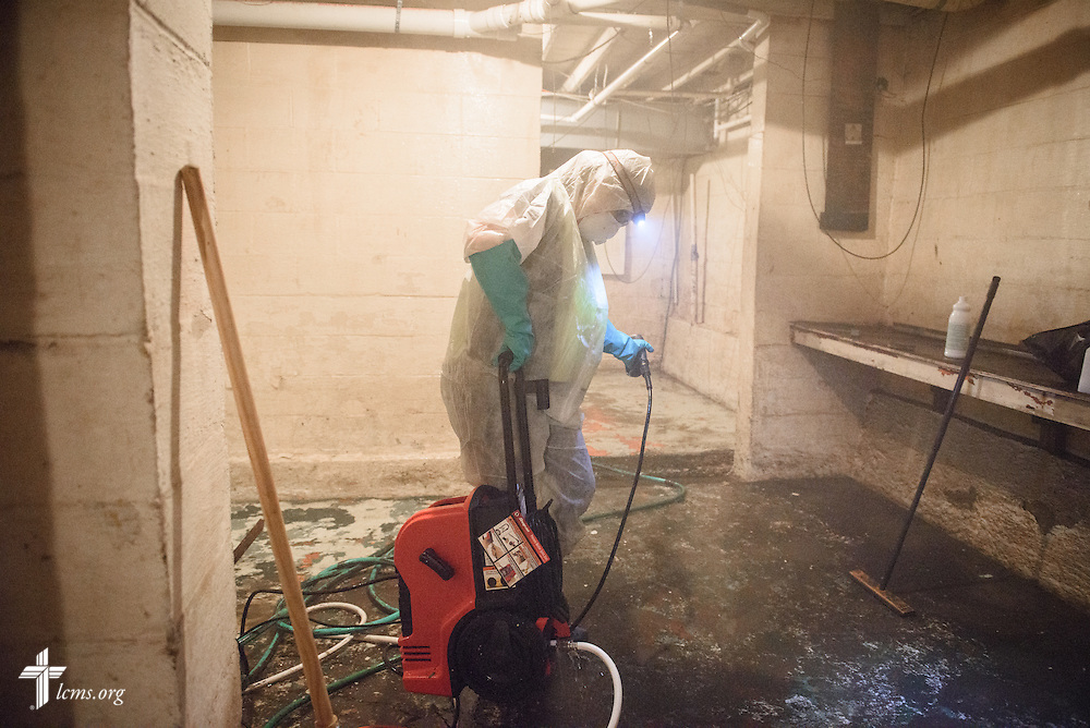 Laura Amidon of Mount Pulaski, Ill., uses a power washer to clean the walls of a home affected by recent flooding during a volunteer cleanup event for flood-damaged homes on Saturday, Jan. 9, 2016, in Watseka. LCMS Communications/Erik M. Lunsford